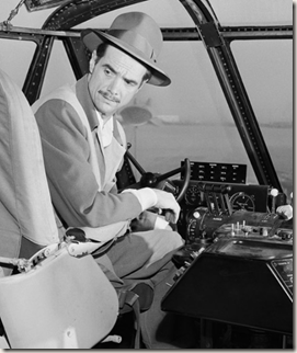 Hughes behind the controls of the Hercules