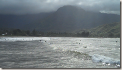 Surfers in Hanalei Bay