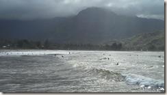 Surfers in Hanalei Bay