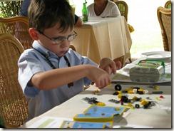Drew assembles a Lego car