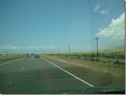 Driving to Kihei - a red dust cloud to the right