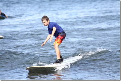 Cameron surfing on Maui